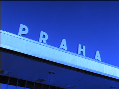 "blue slow motion close up zoom in + zoom out ""praha"" sign at prague airport / czech republic - eastern european culture stock videos & royalty-free footage"