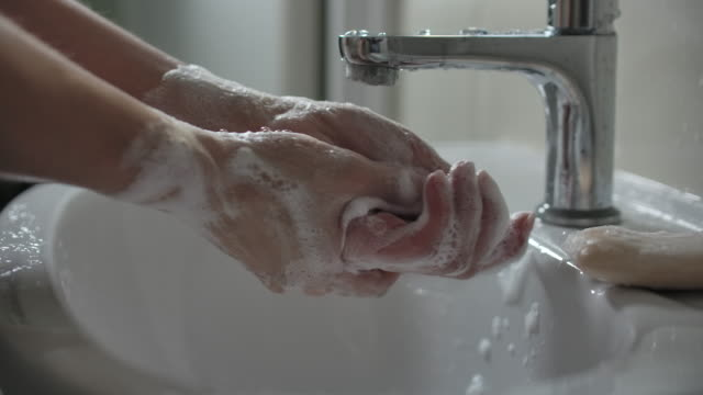 slow motion close-up hand washing with soap - soap sud stock videos & royalty-free footage