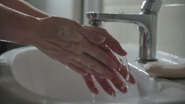 slow motion close-up hand washing with water - sink stock videos & royalty-free footage