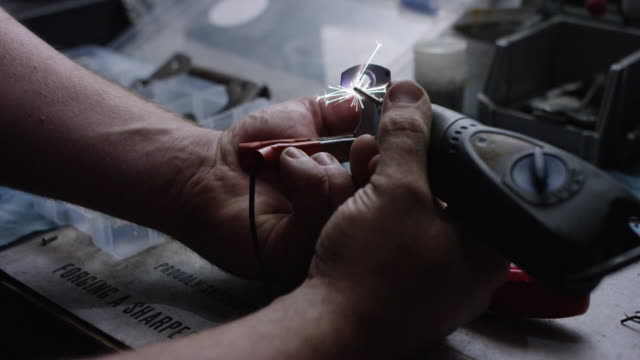 slow motion close-up, hands work with soldering iron - 4k auflösung stock-videos und b-roll-filmmaterial