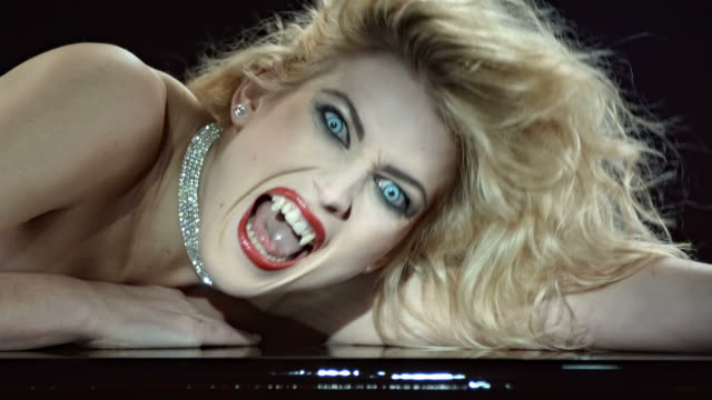 hd slow motion: close-up of a beautiful vampire - vampire stock videos and b-roll footage