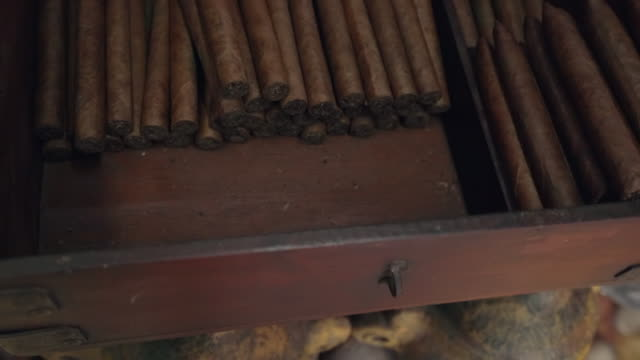 slow motion: close-up of wooden drawer containing row of stacked cigars in el limon, dominican republic - アロマ点の映像素材/bロール