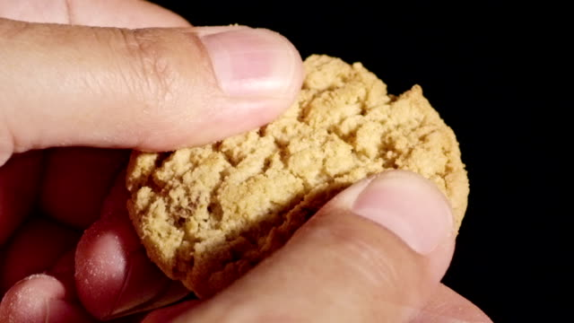slow motion cookie breaking. - biscuit stock videos & royalty-free footage
