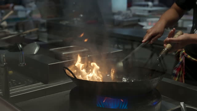4k uhd slow motion: cooking of padthai noodle, thai gourmet cuisine, with flame. - gourmet stock videos & royalty-free footage