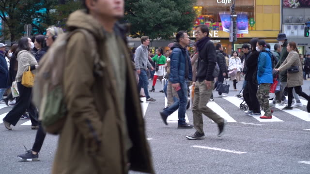 slow motion crowd crossing shibuya junction tokyo japan - hd 25 fps stock videos & royalty-free footage