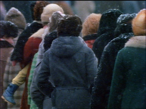 slow motion crowd of people walking in line during snowstorm / moscow - ussr stock videos and b-roll footage