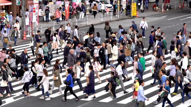 slow motion - crowds of people walking on a crosswalk - pedestrian crossing stock videos and b-roll footage