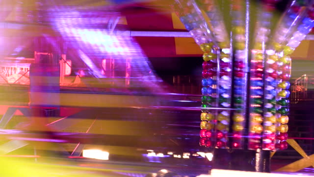 slow motion distorted shot of a fairground waltzer ride. - brighton england stock videos and b-roll footage