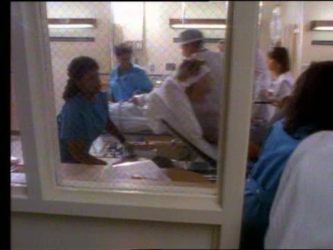 Slow Motion Doctors Nurses Patients In Busy Emergency Room