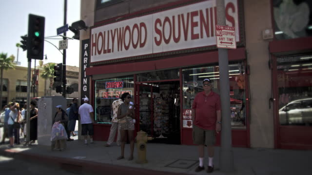 slow motion dolly shot of hollywood blvd. in california - hollywood boulevard stock videos & royalty-free footage