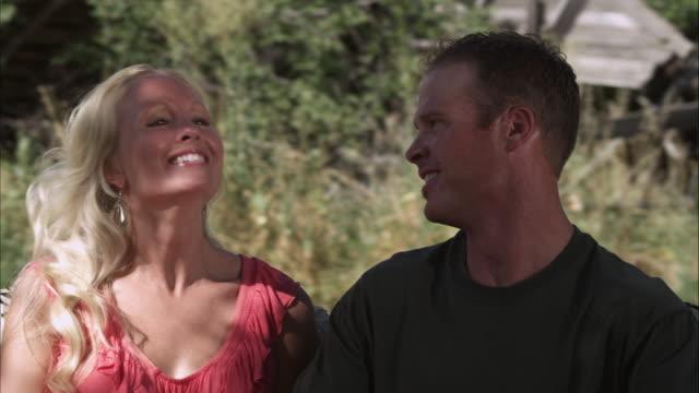 slow motion dolly shot of two caucasian people outdoors - オレム点の映像素材/bロール