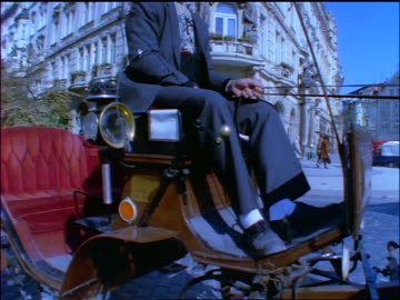 blue slow motion dolly shot up carriage driver sitting on carriage in old town square / prague, czech republic - prague old town square stock videos & royalty-free footage