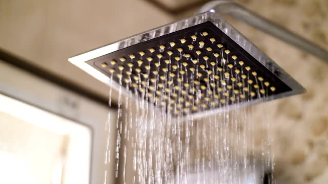 slow motion : drops of water falling from rain shower - domestic bathroom stock videos & royalty-free footage