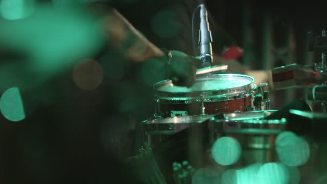 Slow motion, drummer plays drums
