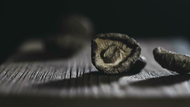 slow motion : dry mushrooms on rustic wood - shiitake stock videos & royalty-free footage