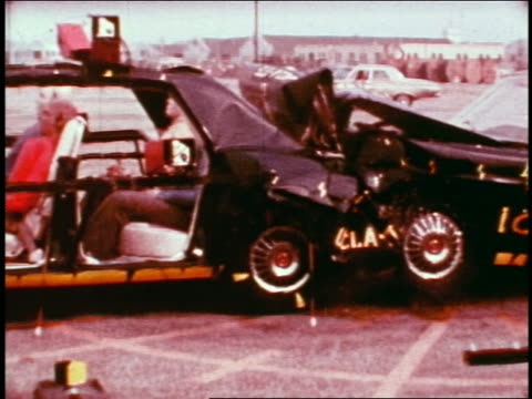 1968 slow motion dummies in car getting rear ended in collision on test track / educational - crash test stock videos & royalty-free footage