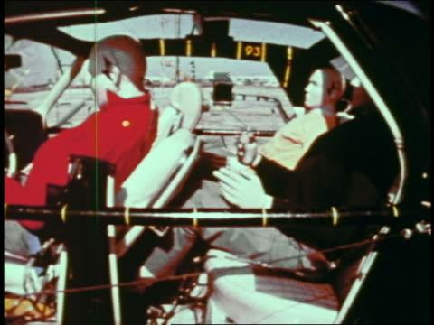 1968 slow motion (high speed) dummies in car getting whiplash in collision on test track / educational - testdocka bildbanksvideor och videomaterial från bakom kulisserna