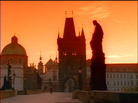 slow motion pan empty charles bridge at sunset / prague, czech republic / red filter - charles bridge stock videos & royalty-free footage