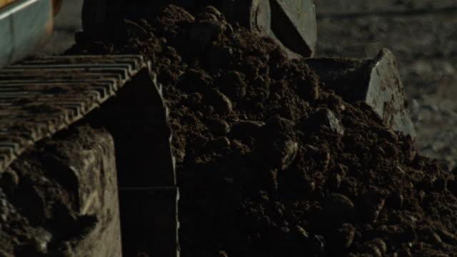 slow motion excavator dirt dump machine construction - bulldozer stock videos & royalty-free footage