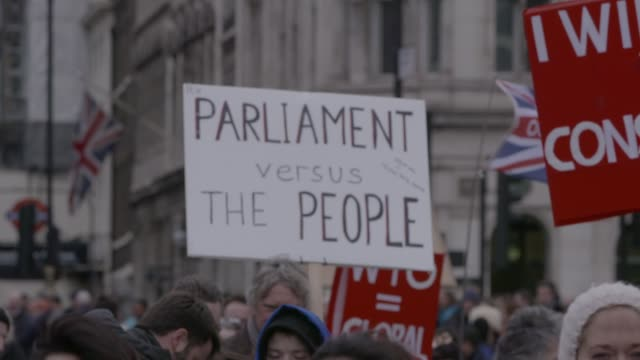 slow motion exterior shot of probrexit protester demonstrating outside the houses of parliament on 13 march in london 2019 united kingdom - referendum stock videos & royalty-free footage