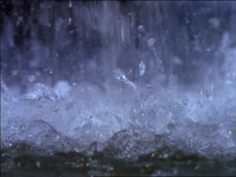 slow motion extreme close up water bubbling from fountain / France