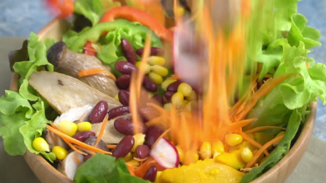 slow motion falling of vegetable on mixing salad bowl. - salad bowl stock videos & royalty-free footage