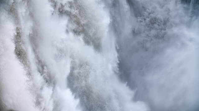 slow motion: falling water at dettifoss waterfall - waterfall stock videos & royalty-free footage
