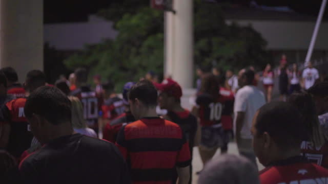 slow motion: fans walk while leaving a soccer match - offense sporting position stock videos and b-roll footage