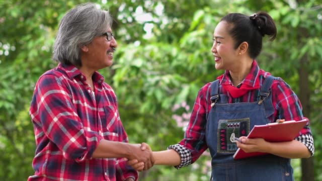 Slow motion: Farmer shake hand for trading.