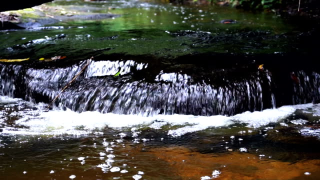 slow motion fhd footage of small waterfall in forest with bubbles in cambodia, nature and environment concept - cascade range stock videos & royalty-free footage