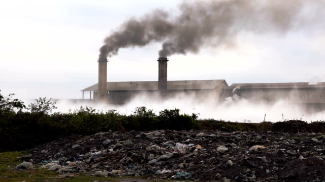 slow motion fhd footage of smokestack factory at the countryside at evening time, industry and pollution concept - coal stock videos & royalty-free footage