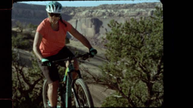 slow motion film footage of women mountain biking in moab. - cycling helmet stock videos & royalty-free footage
