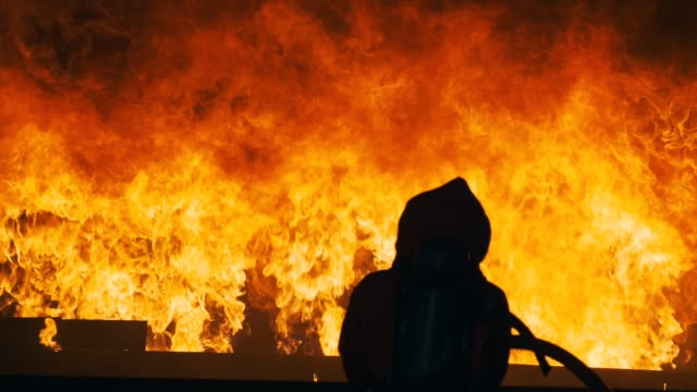 slow motion : firefighter training with flame - inferno stock videos and b-roll footage