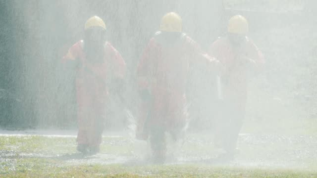 slow motion : firefighters after fire extinguishing - traditional helmet stock videos and b-roll footage