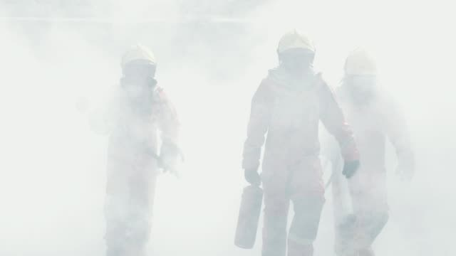 vídeos de stock e filmes b-roll de slow motion : firefighters after fire extinguishing - traditional helmet