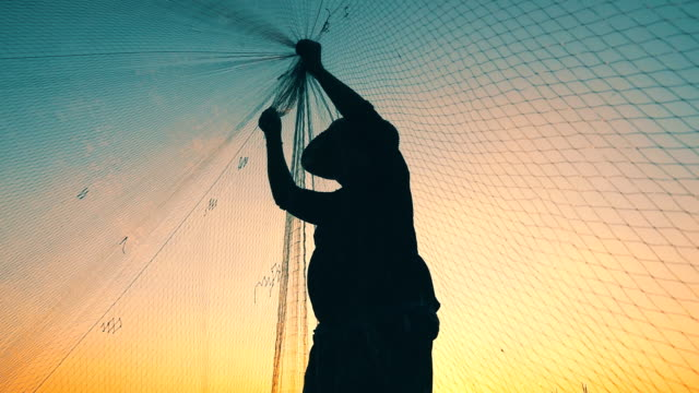 hd slow motion: fishermen are fishing with nets - fishing net stock videos & royalty-free footage
