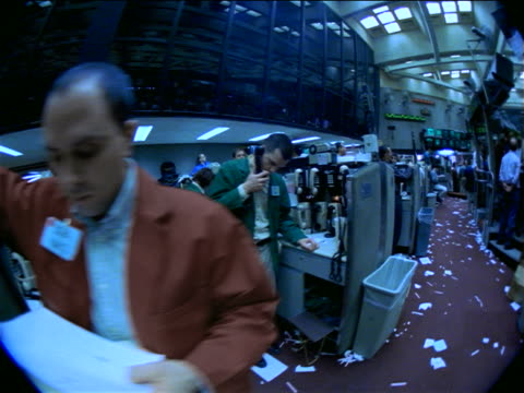 blue slow motion fisheye point of view male traders on littered floor of coffee, sugar + cocoa exchange, nyc - agente di cambio video stock e b–roll