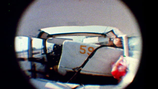 1968 slow motion fisheye rear view crash test dummies in front seat of car during test crash - crash test stock videos & royalty-free footage