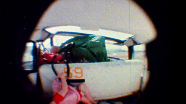 1968 slow motion fisheye rear view three crash test dummies flying around in car during test crash - crash test stock videos & royalty-free footage