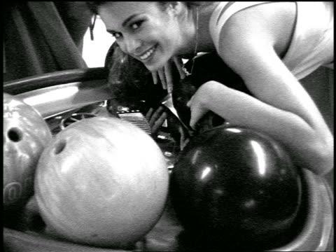vídeos y material grabado en eventos de stock de b/w slow motion flash frames bridesmaid posing with bowling balls in bowling alley - bola de bolos