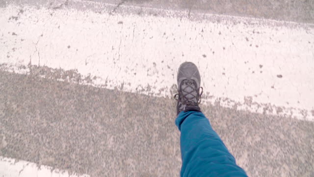 slow motion: pov foot walking on the pedestrian crossing - crosswalk stock videos & royalty-free footage