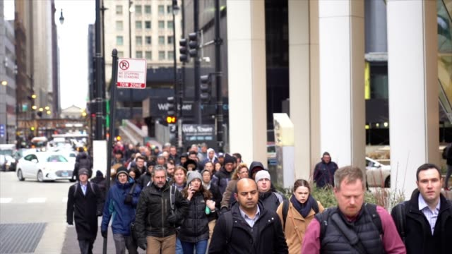 4k slow motion footage crowd of pedestrians walking on the street in rush hour among modern buildings in chicago, illinois, united states, business and american culture concept - chicago stock videos & royalty-free footage
