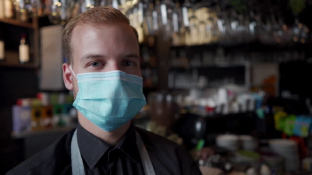 slow motion footage of a bartender wearing protective face mask - pub stock videos & royalty-free footage