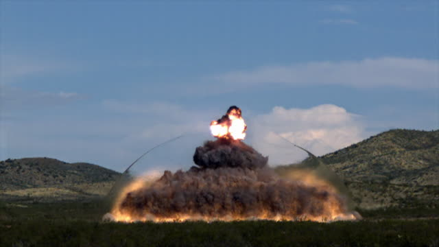 Slow motion footage of a large explosion with a visible shock wave