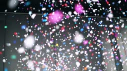 4K Slow motion footage of colorful confetti falling from above in the room, Celebrating with happy new year and Party concept
