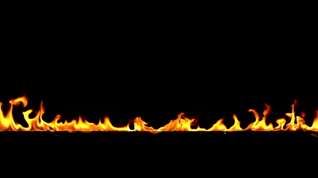 vídeos de stock e filmes b-roll de slow motion footage of fire flame border isolated on black background - part of a series