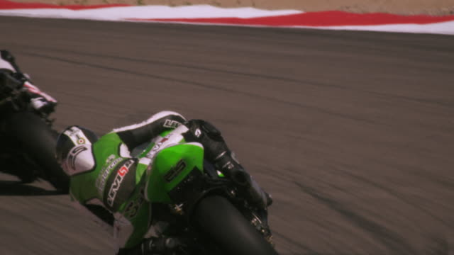 slow motion footage of motorcycle race - motorcycle racing stock videos and b-roll footage