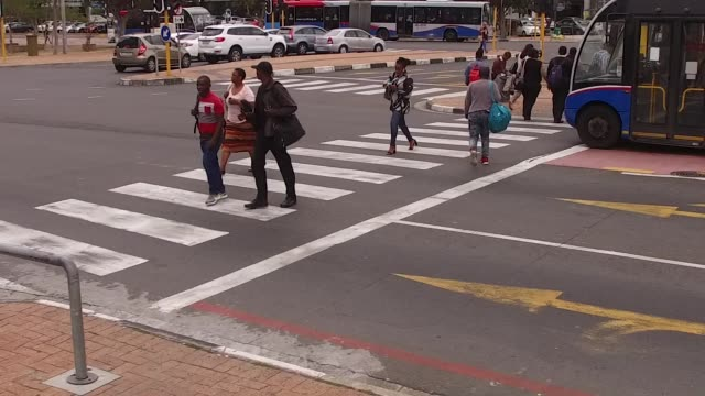 slow motion footage of pedestrians at road crossings in cape town, south africa on friday, february 23 photographer: waldo swiegers/bloomberg - cape town stock videos & royalty-free footage