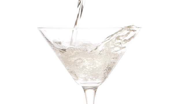 slow motion footage of pouring martini into a martini glass - rubbing alcohol stock videos & royalty-free footage