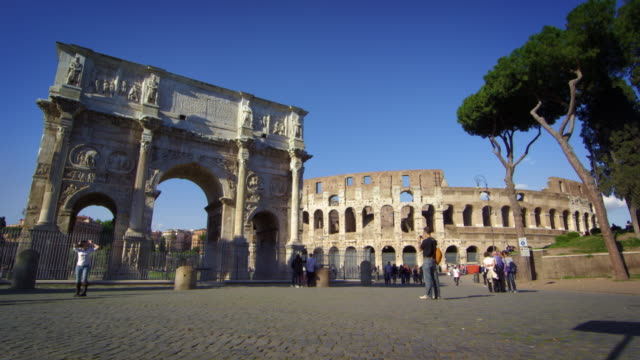 slow motion footage of the arch of constantine and colosseum - arch of constantine stock videos and b-roll footage